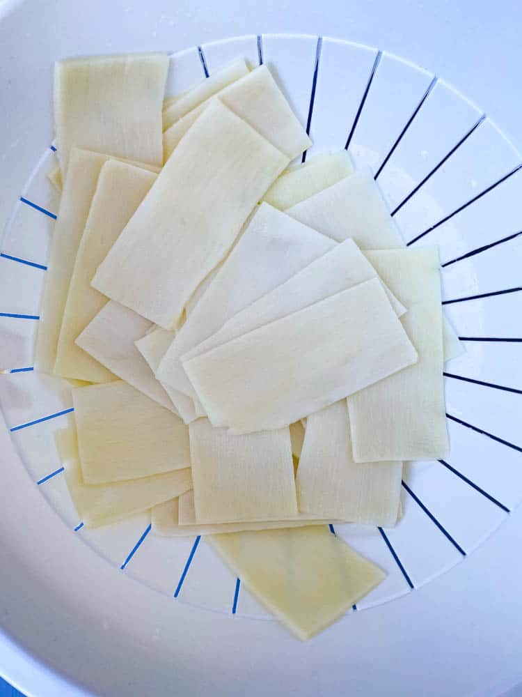 rinsed Palmini lasagna sheets in a white bowl