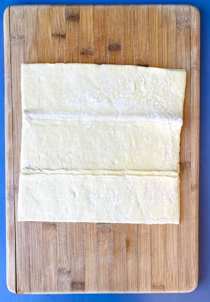 puff pastry on a bamboo cutting board