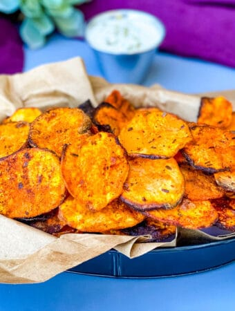 air fryer sweet potato chips in a black bowl with dipping sauce