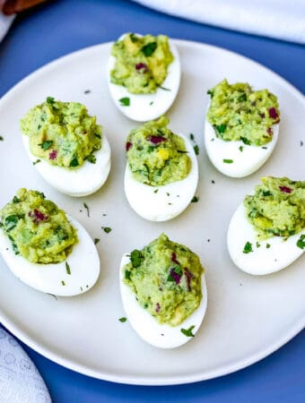 avocado deviled eggs on a white plate