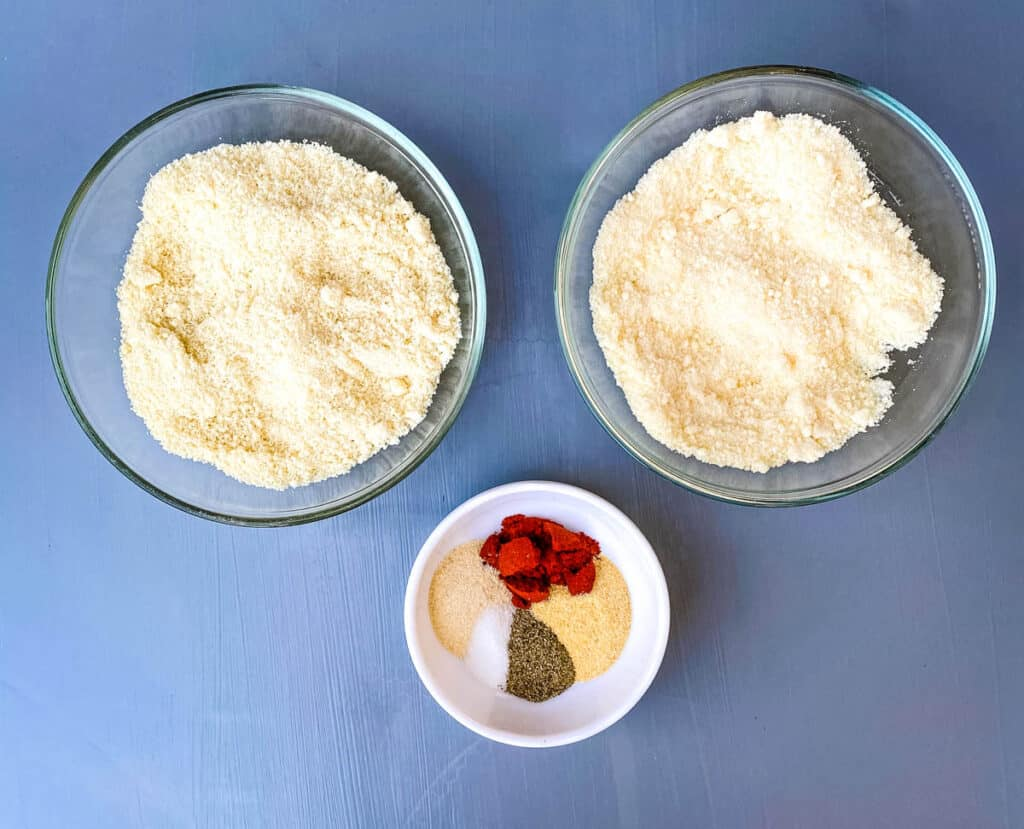 grated parmesan, almond flour, and seasonings in separate bowls