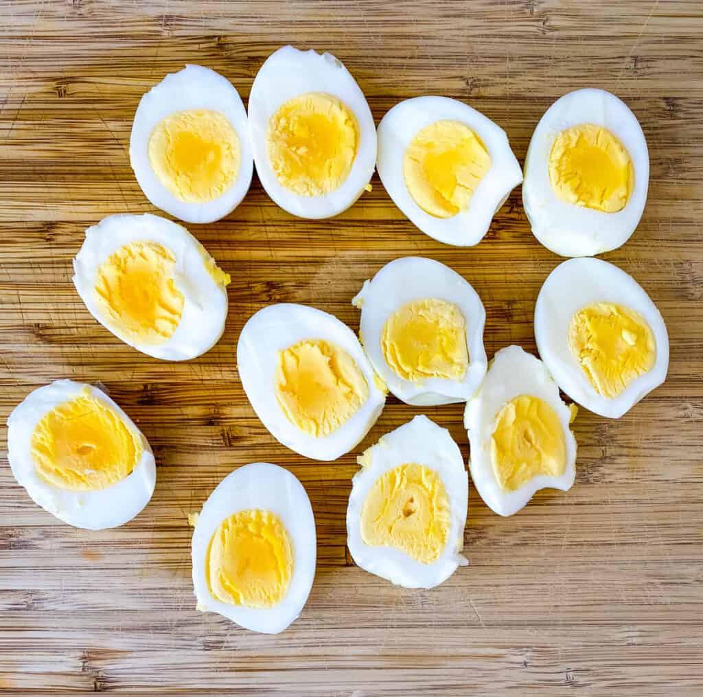 hard boiled eggs sliced in half on a cutting board
