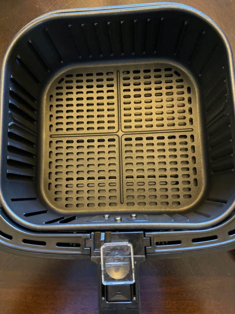 a clean air fryer basket on a flat surface