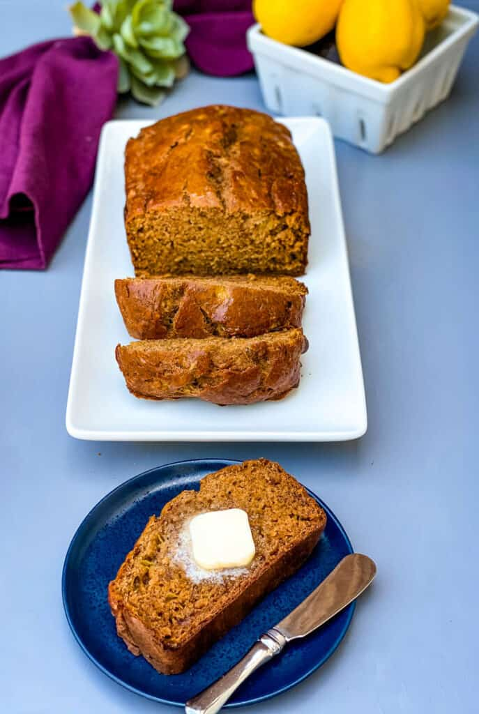 healthy banana bread sliced on a white plate
