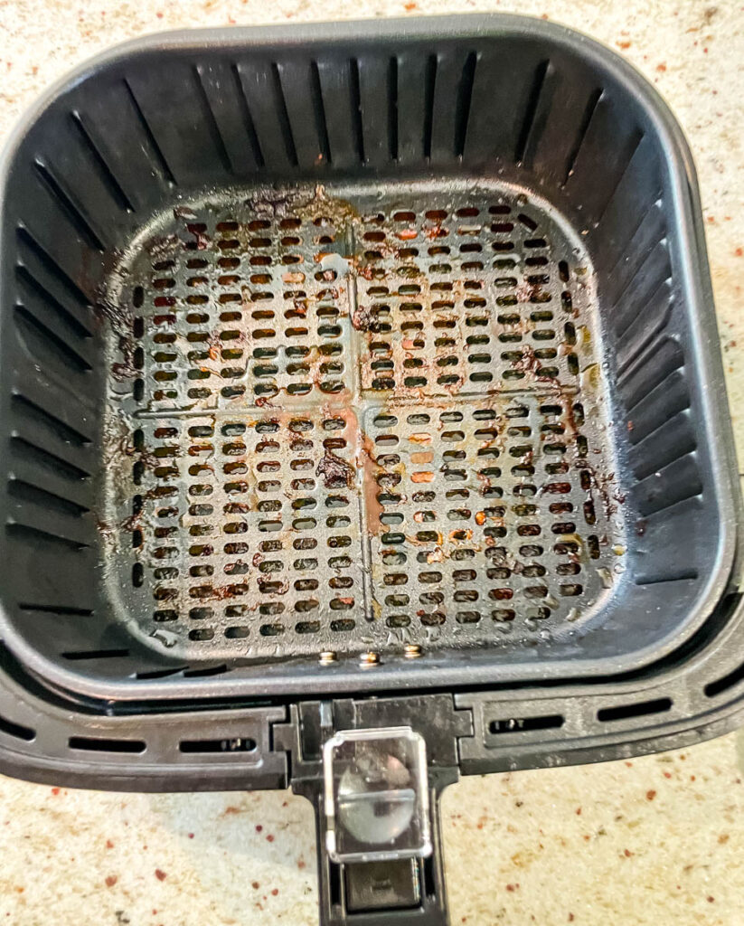air fryer basket with water and dish liquid