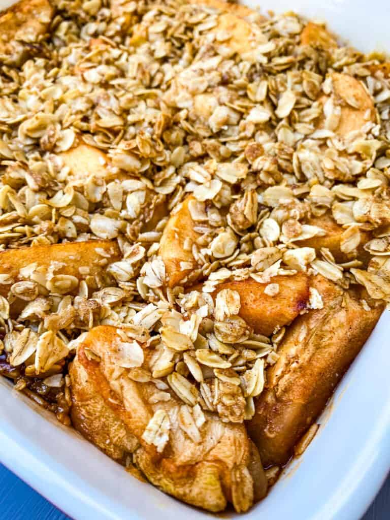healthy apple crisp in a red baking dish