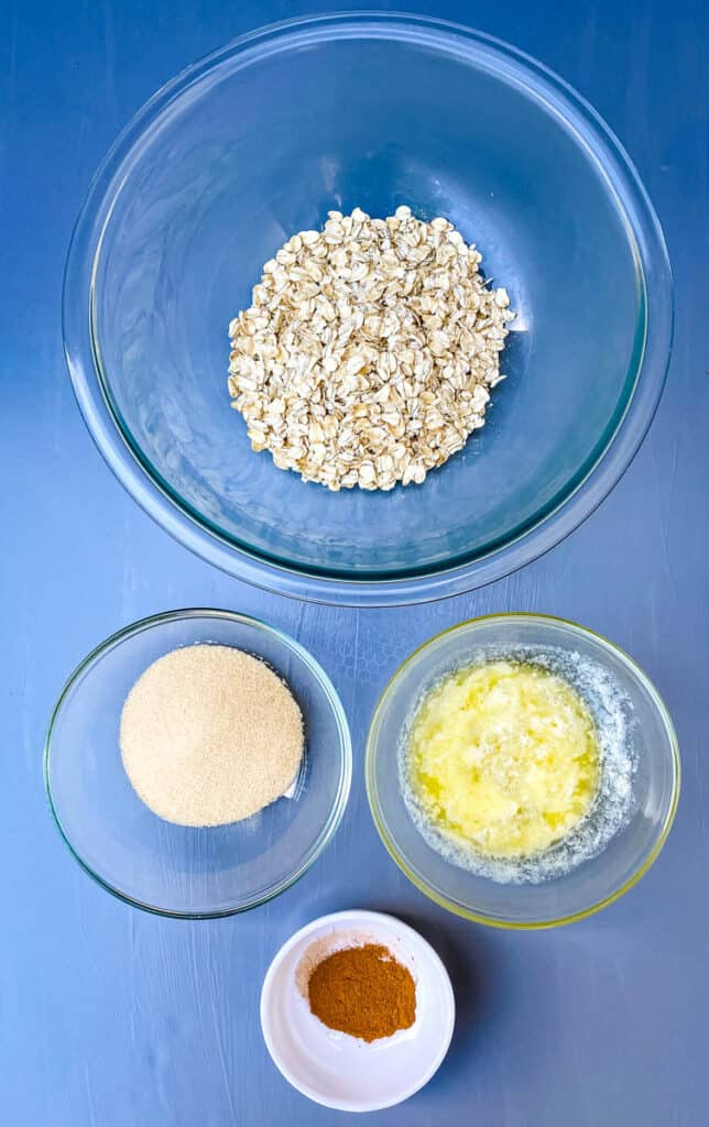 rolled oats, melted butter, brown sweetener, and cinnamon in separate bowls