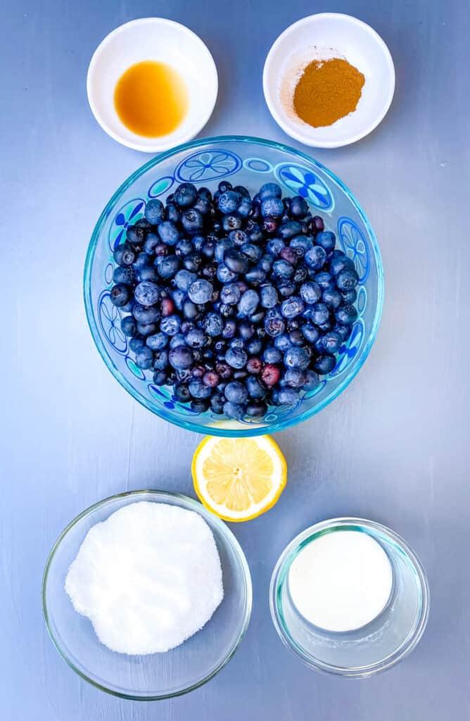 fresh blueberries, lemon, cornstarch, vanilla, sweetener, and cinnamon in separate bowls