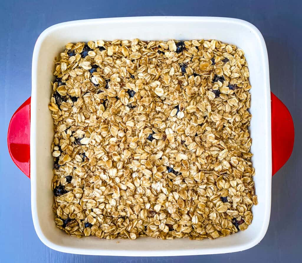 unbaked healthy blueberry crisp in a baking dish