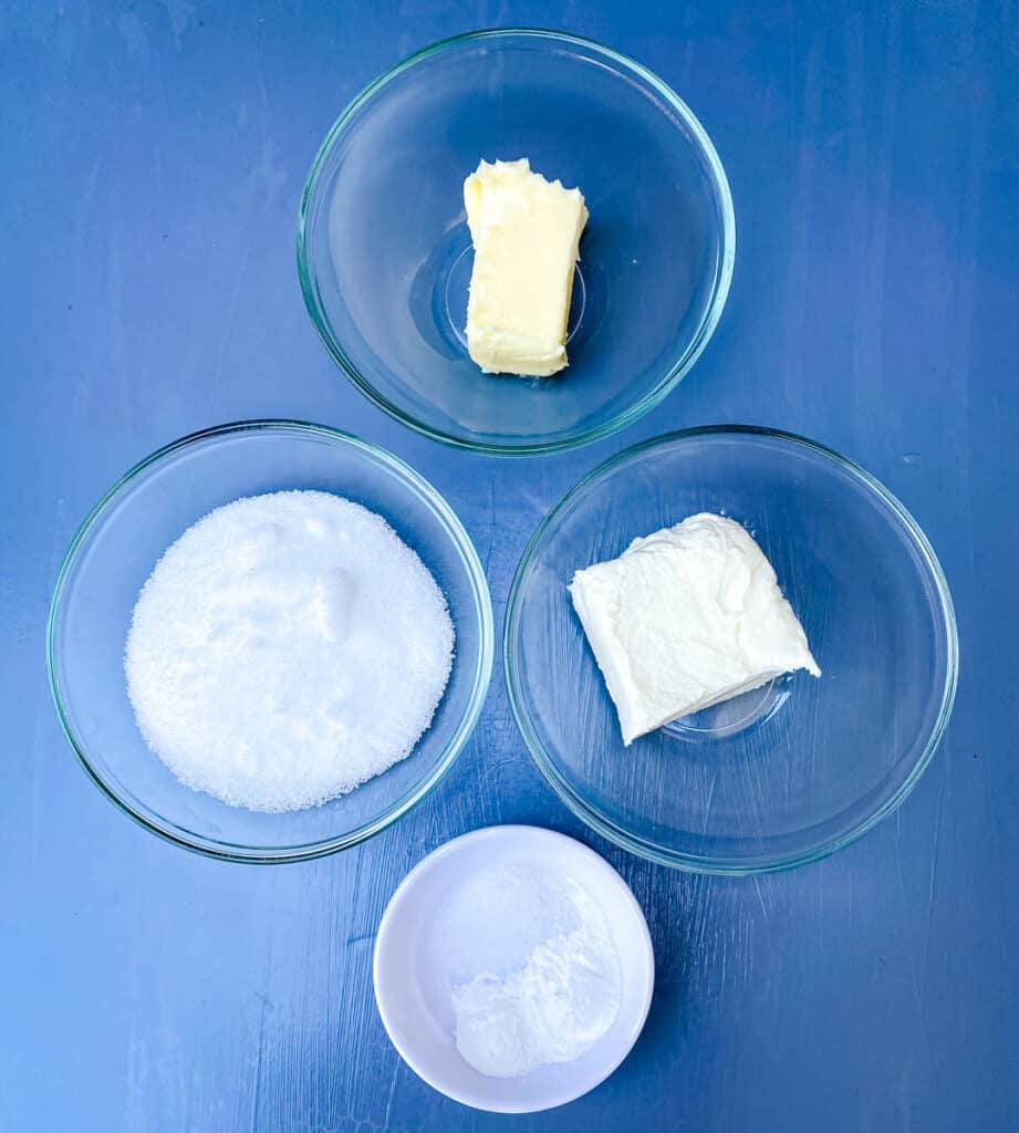 butter, cream cheese, sweetener, baking powder, and salt in separate bowls on a flat surface