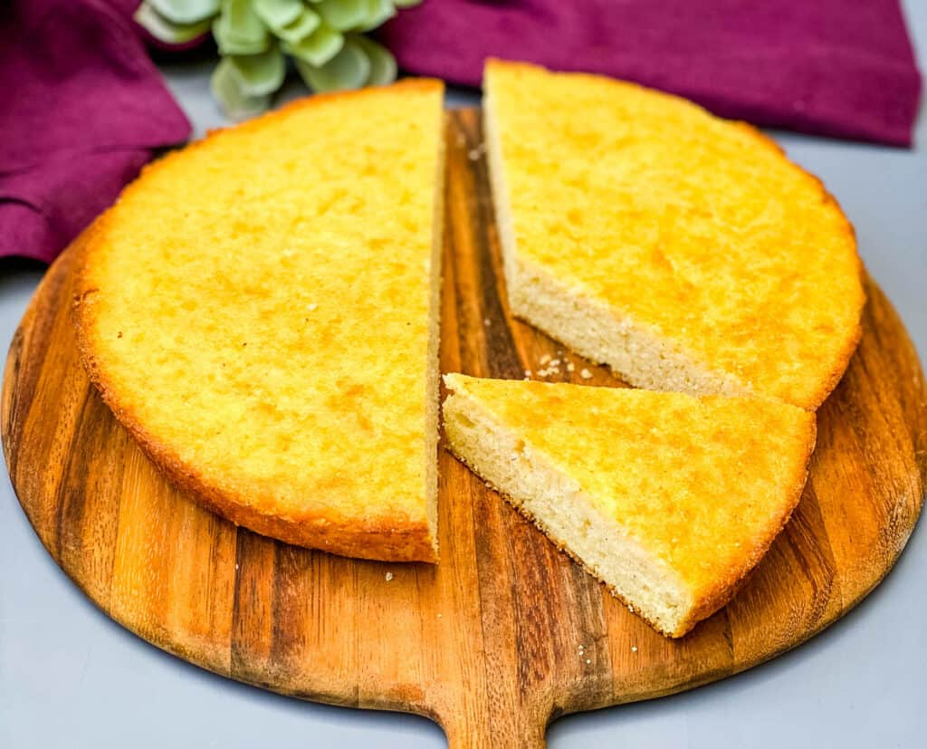 Southern homemade cornbread sliced on a brown board