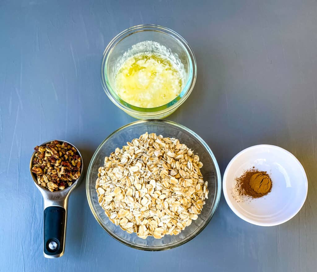 rolled oats, pecans, cinnamon, and melted butter in separate bowls
