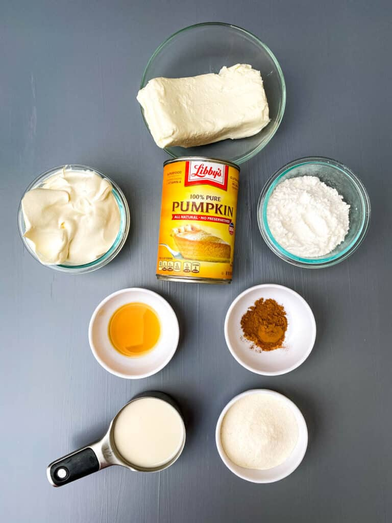 cream cheese, whipped topping, powdered sweetener, pure canned pumpkin, and pumpkin pie spice in separate bowls