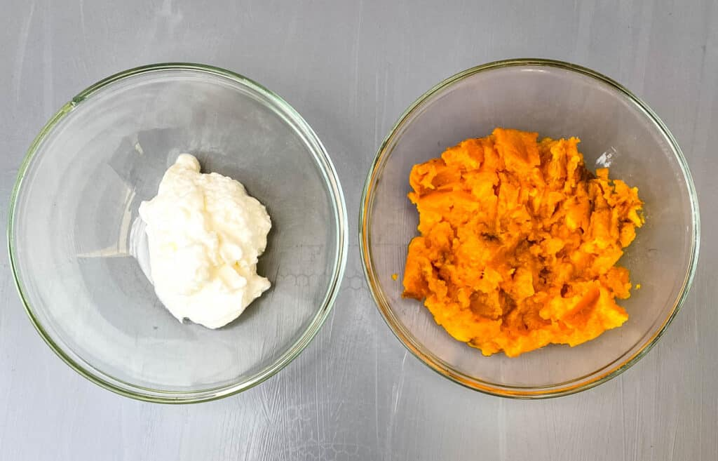 Greek yogurt and mashed sweet potatoes in separate glass bowls