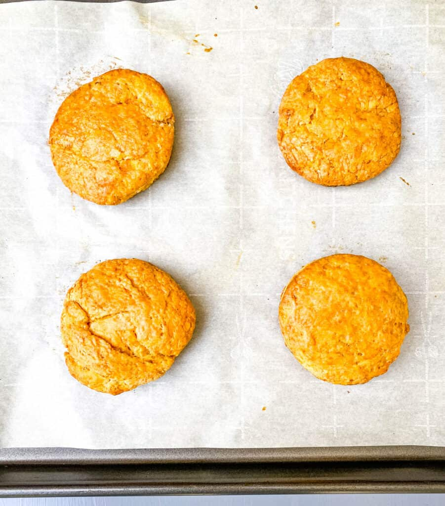 baked sweet potato biscuits on a sheet pan