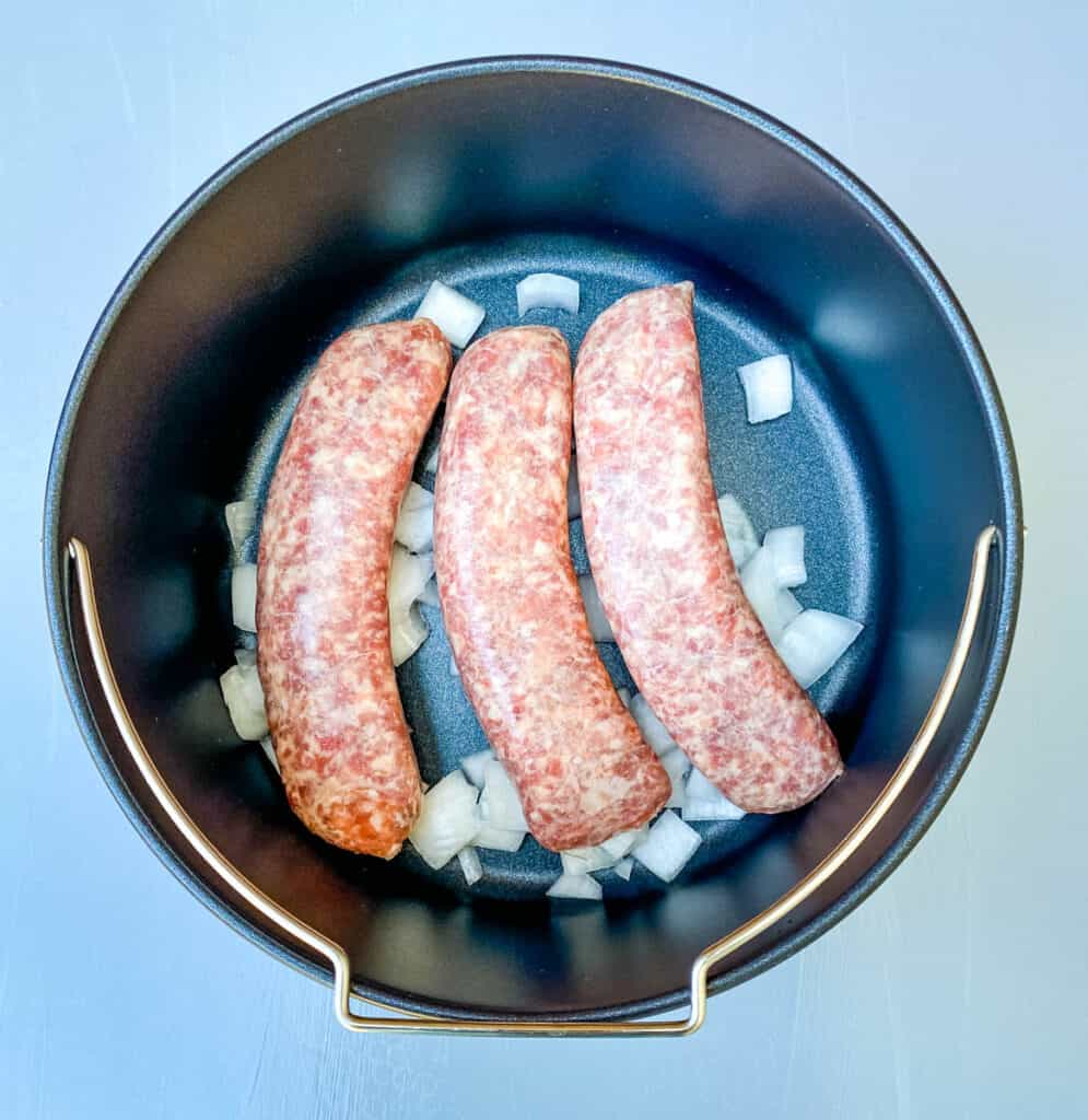 brats in an air fryer with onions