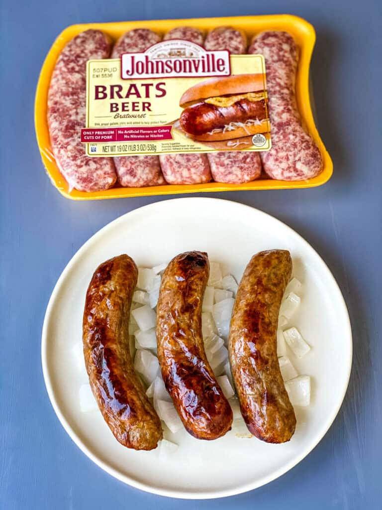 air fryer brats on a plate with onions