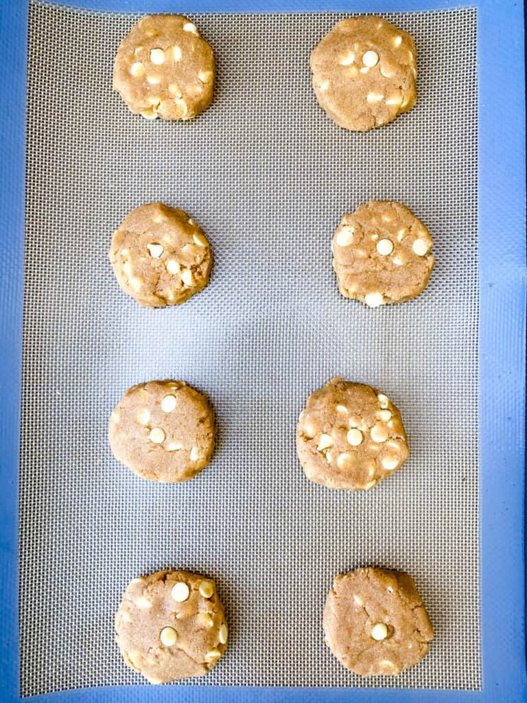 keto gingersnap cookies unbaked on a cookie sheet