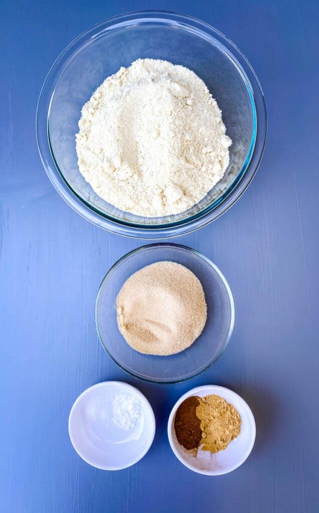 almond flour, golden sweetener, cinnamon, and baking powder in separate bowls