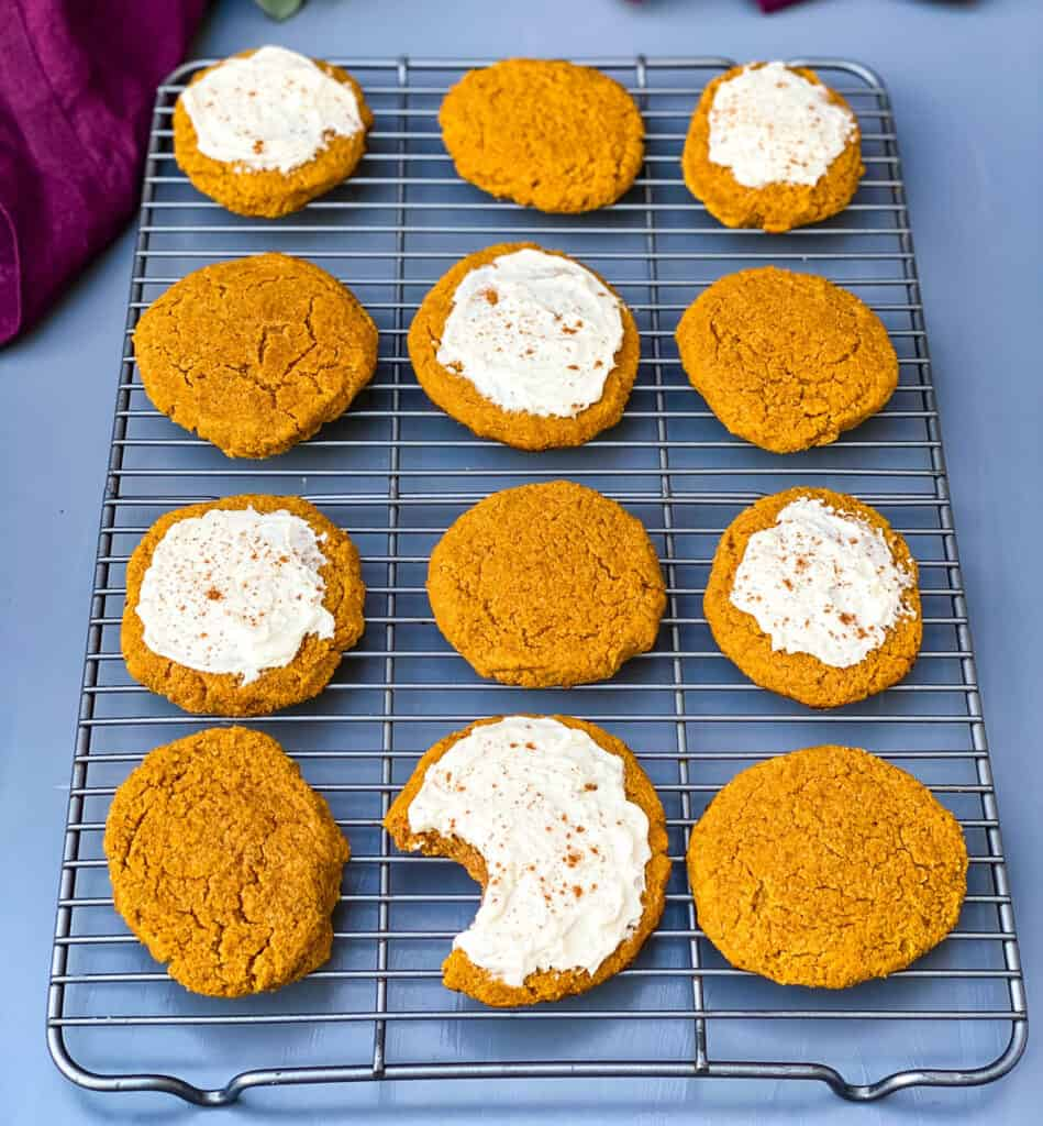 keto pumpkin cookies with icing on a cooling rack