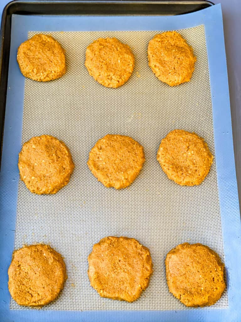 baked keto pumpkin cookies on a cookie sheet