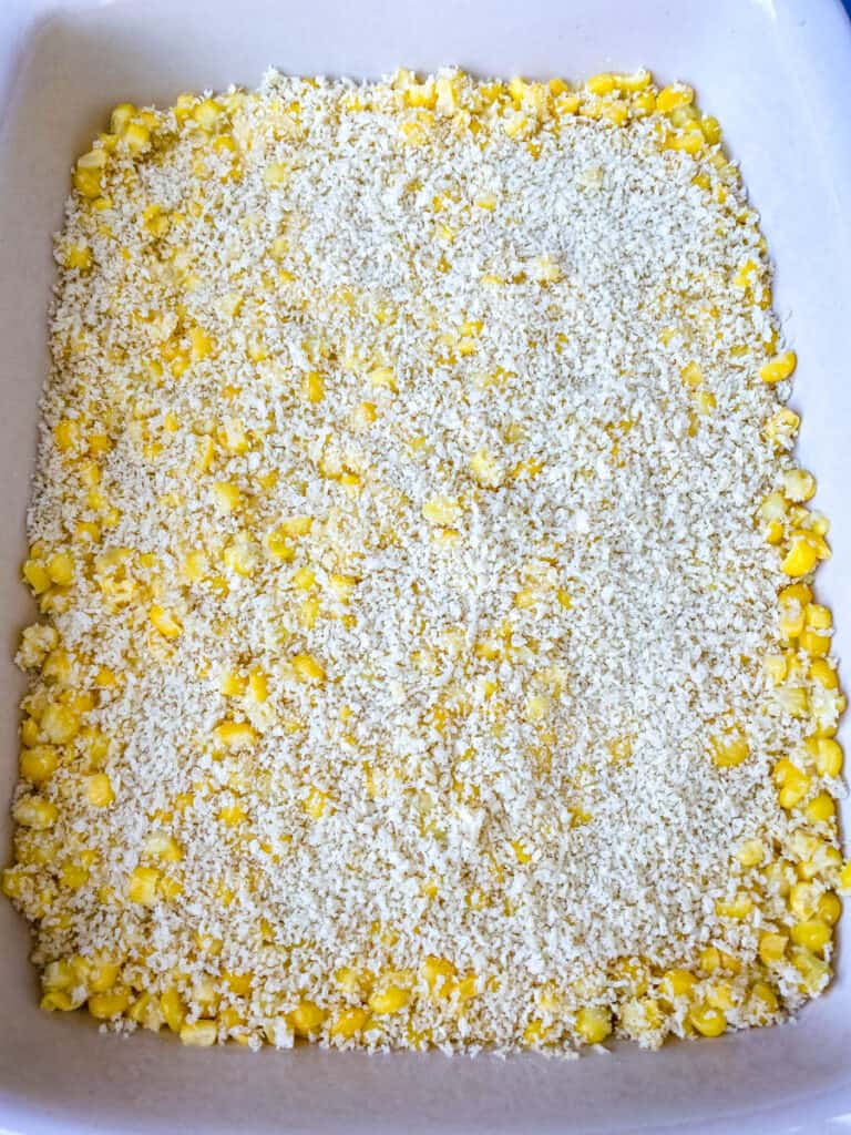 uncooked scalloped corn in a baking dish