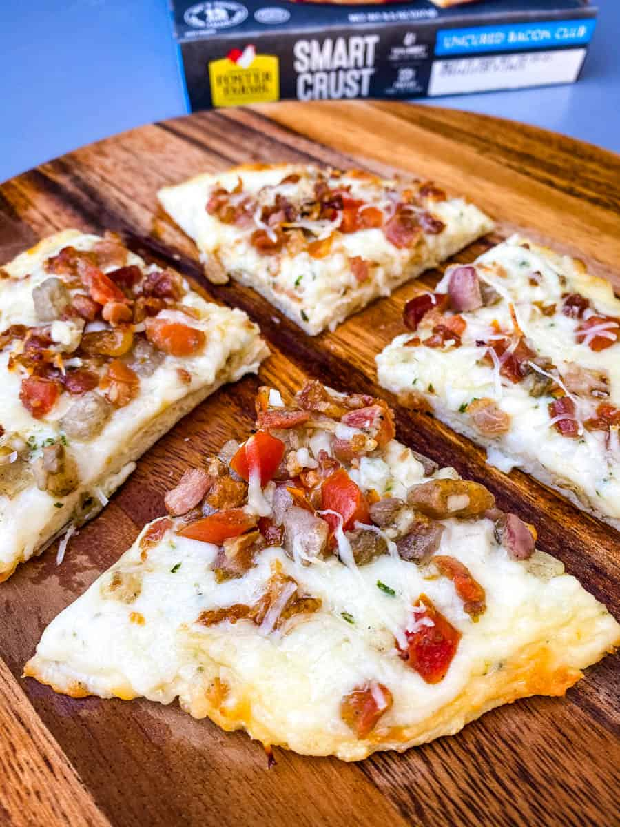 cooked smart crust pizza on a wooden surface