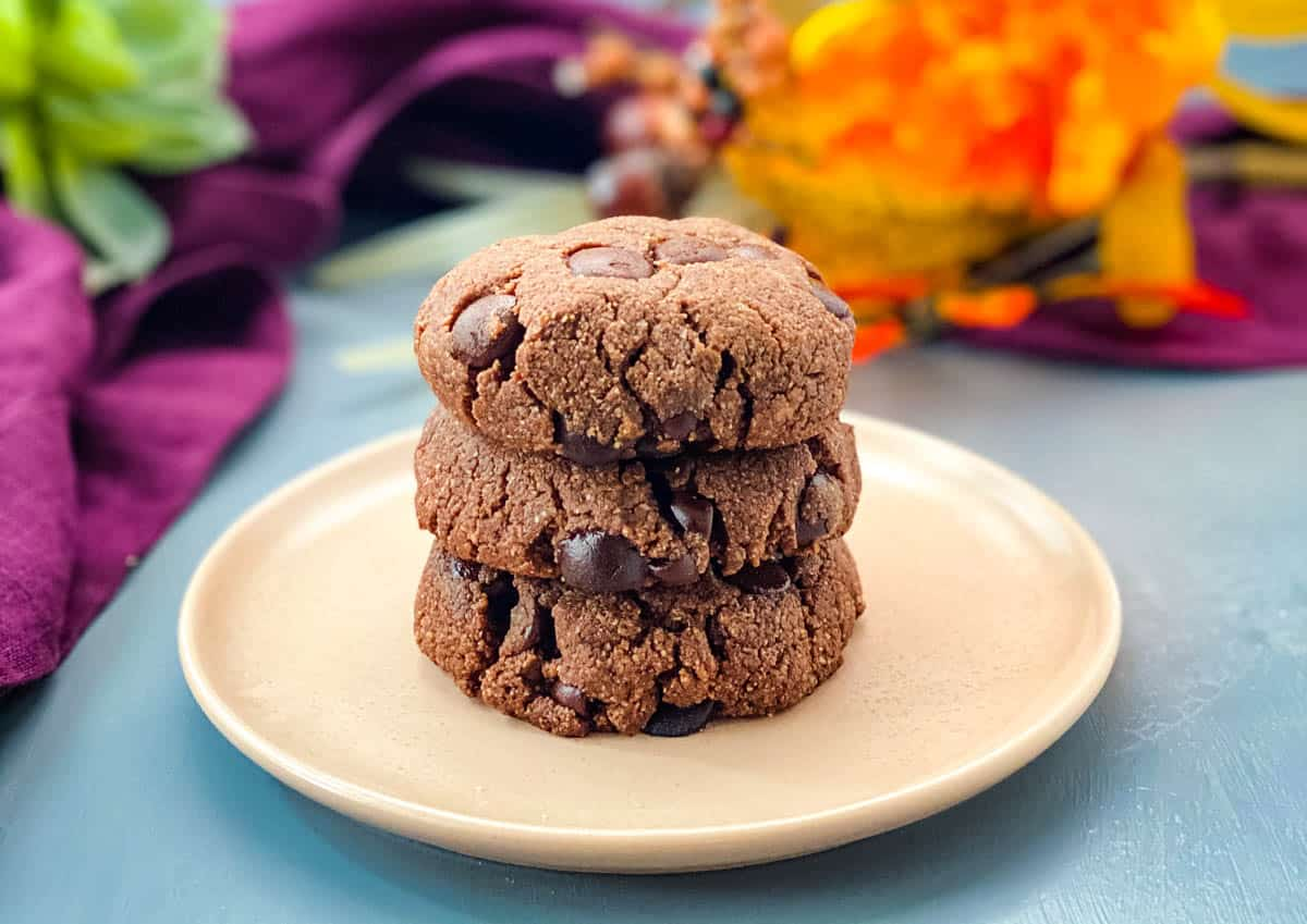 keto low carb double chocolate cookies on a pink plate with a purple napkin
