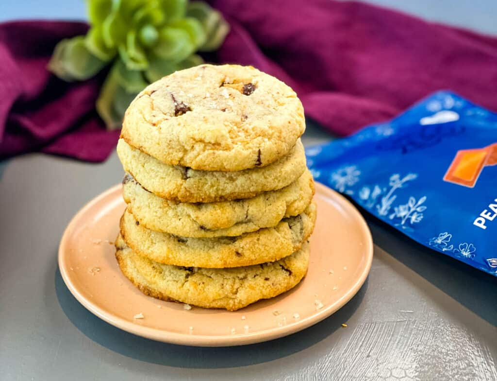 a stack of keto low carb peanut butter cup cookies on a pink plate