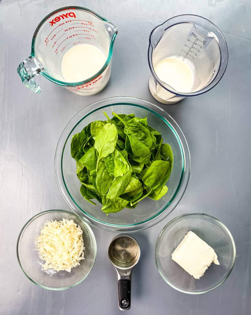 heavy cream, milk, fresh spinach, parmesan cheese, white wine, and cream cheese in separate bowls