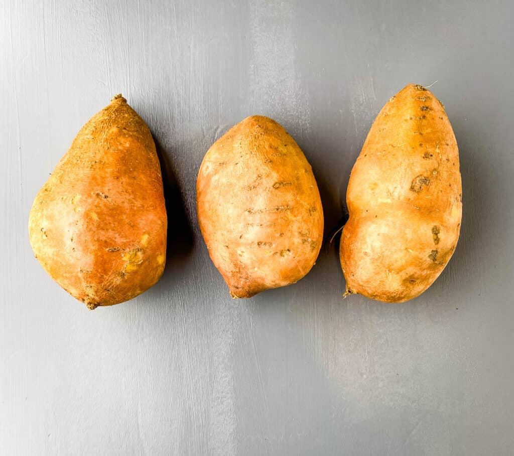 raw sweet potatoes on a flat surface