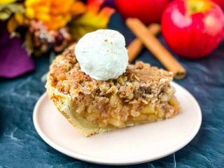 sugar free apple pie on a pink plate with vanilla ice cream