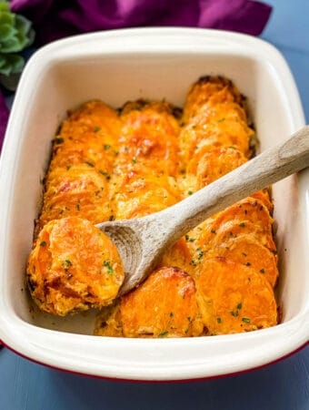 au gratin sweet potatoes in a red baking dish