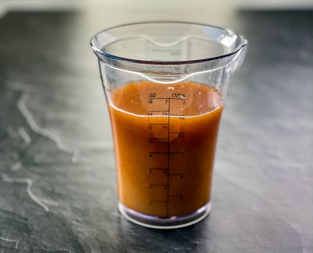 turkey injection marinade in a measuring cup