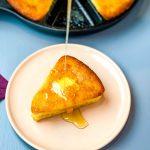 honey drizzled onto a slice of cornbread