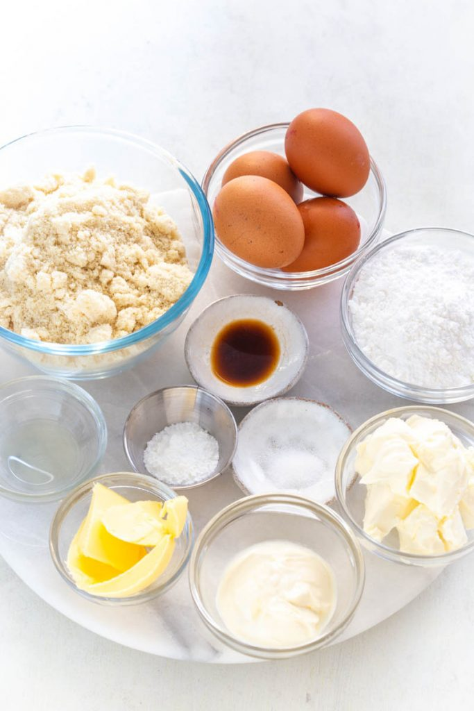 almond flour, raw eggs, butter, vanilla, and sweetener in separate bowls