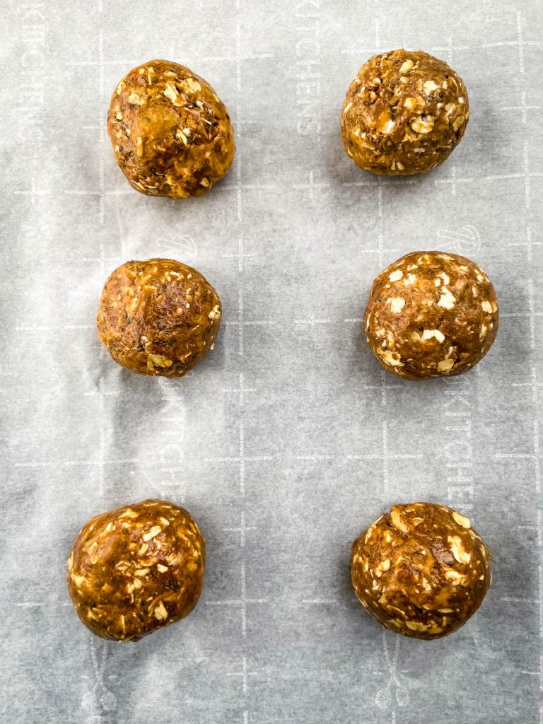 almond butter protein balls on parchment paper