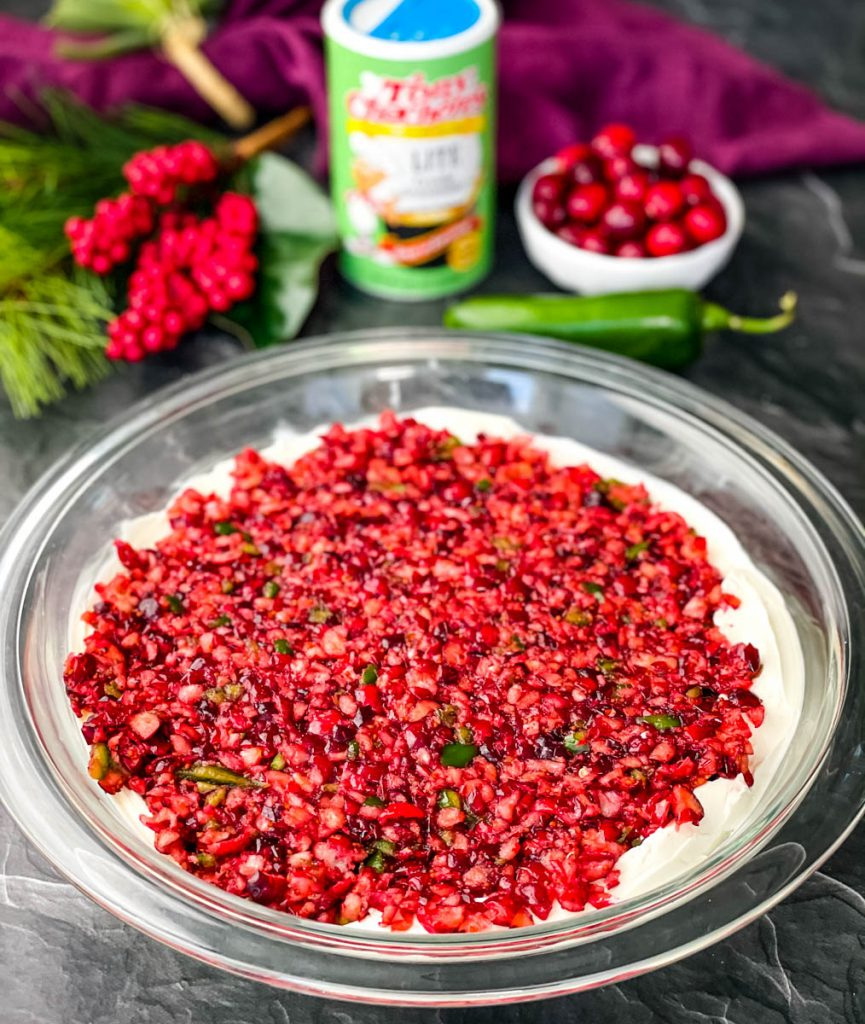 jalapeno cranberry dip with cream cheese in a glass bowl