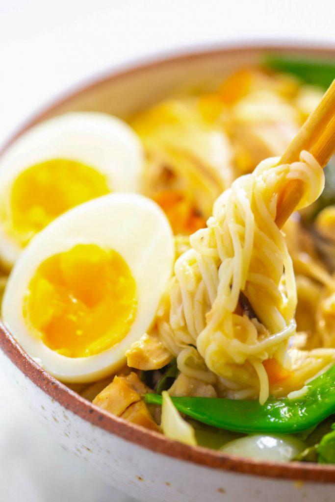 Instant Pot chicken ramen in chopsticks