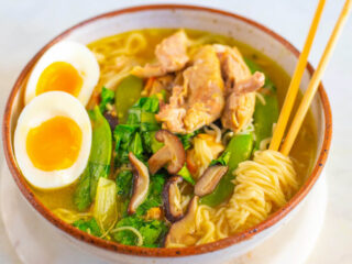 Instant Pot chicken ramen in a bowl with chopsticks