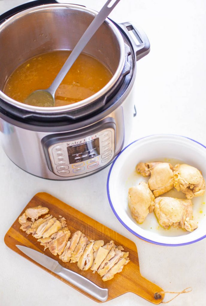 cooked chicken thighs in an Instant Pot with broth