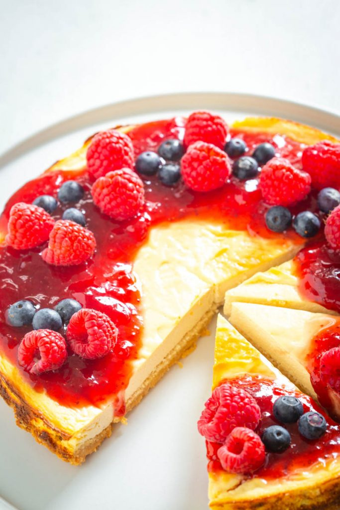 sugar free cheesecake on a plate with berries