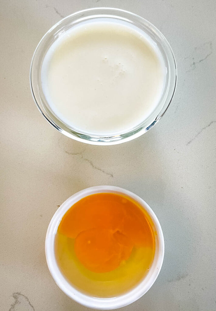 buttermilk and raw eggs in separate bowls