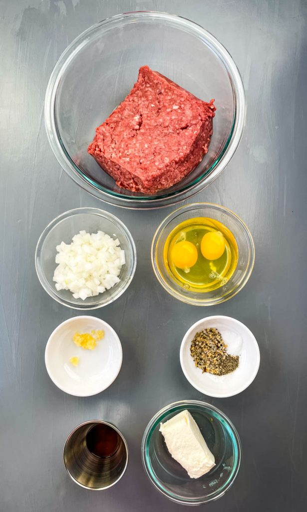 ground beef, chopped onions, raw eggs, cream cheese, garlic, and seasonings in separate glass bowls