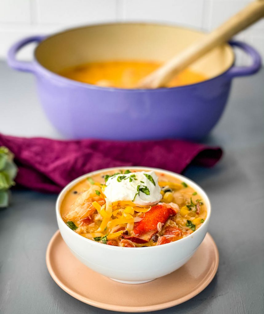 creamy seafood chili with shrimp and lobster in a white bowl
