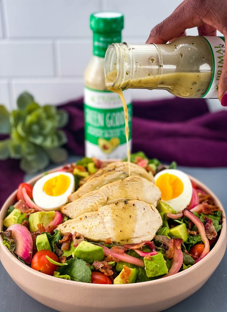 salad dressing drizzled over green goddess cobb salad