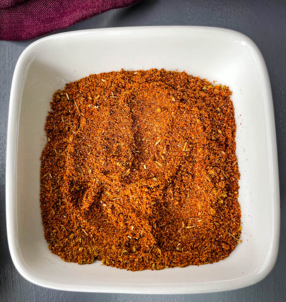 homemade chili seasoning in a white bowl