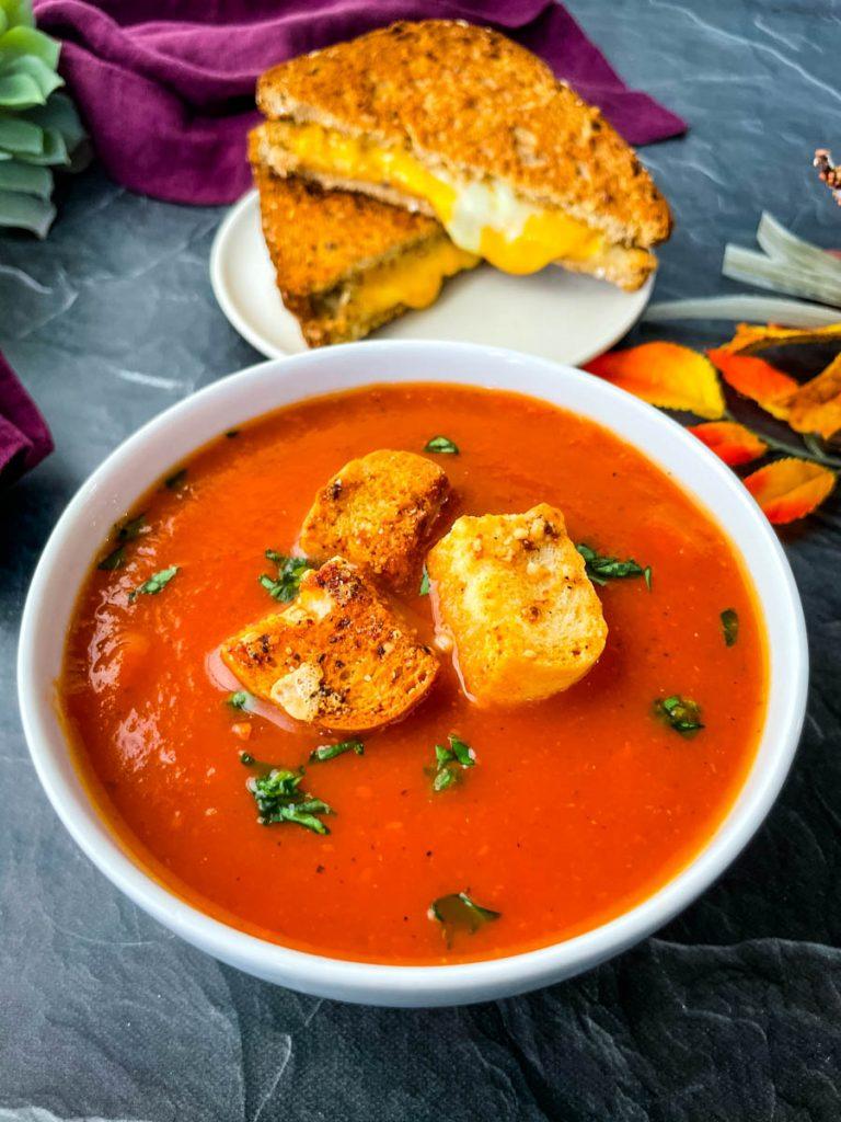 Instant Pot tomato soup in a white bowl