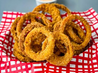 keto low carb onion rings in a red and black basket
