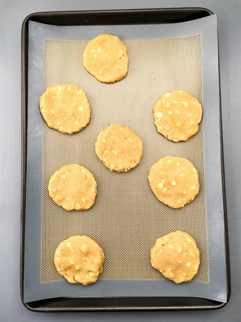 unbaked keto macadamia nut cookies on a cookie sheet